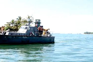 The Navy bringing the fishing trawler to the Galle Harbour.
