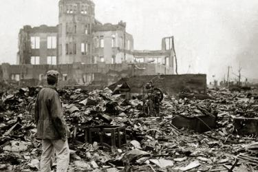 A man stands in a sea of rubble before the shell of a building that once was a movie theatre in Hiroshima on September 8, 1945, a month after the first atomic bomb ever used in warfare was dropped by the United States to hasten Japan's surrender.