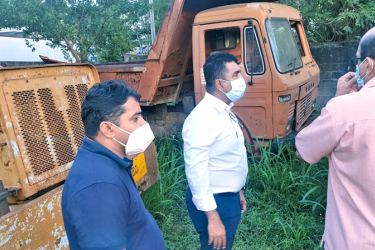 Minister Johnston Fernando inspecting the machinery.
