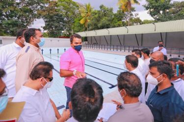 Sports Minister Namal Rajapaksa instructing officials at the swimming pool complex near Bernard Aluvihare Stadium.