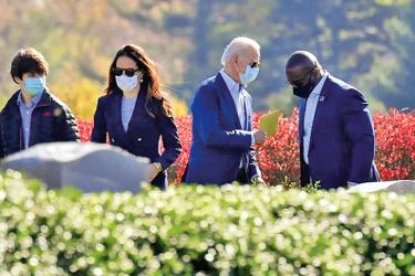 US President-elect Joe Biden (2ndR) and his daughter Ashley Biden (C) leave after visiting their family grave at St. Joseph on the Brandywine Roman Catholic Church in Wilmington.- AFP.