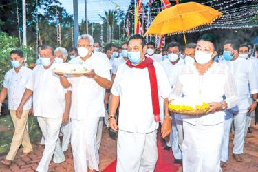 The President and the  Prime Minister attending religious observances in Anuradhapura