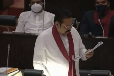 Prime Minister Mahinda Rajapaksa presenting the Budget 2021 as Finance Minister in Parliament yesterday. (Picture by Parliament Media)