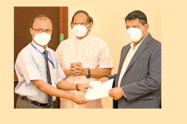 A local contract company representative receiving a contract agreement from State Minister  Dr Nalaka Godahewa.