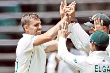 South Africa's Anrich Nortje (L) finished with his best figures yet for South Africa during the first day of the second Test cricket match against Sri Lanka on Sunday.  - AFP