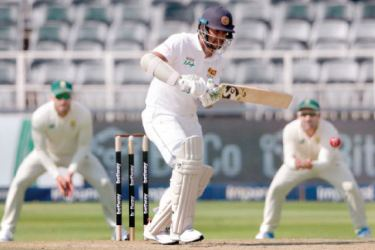 Sri Lanka's captain Dimuth Karunaratne plays a shot during his unbeaten knock of 91. AFP