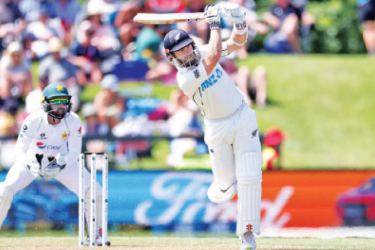 New Zealand's captain Kane Williamson plays a shot during day two of the second international cricket Test match between New Zealand and Pakistan at Hagley Oval in Christchurch on January 4. AFP