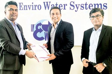 Managing Director, Enviro Water Systems Surath Senavirathna exchange the agreement with Director CTO of Bileeta, Sanka Weeerasinghe and Head of Business Development of Bileeta, Benton M. Samuel