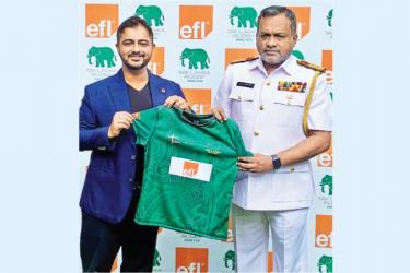 Saif Yusoof - the Managing Director of EFL handing over the jersey to Rear Admiral H.A.U.D. Hettiarachchi – the Sri Lanka Rugby Vice President and Chairman of Women's Development and High Performance