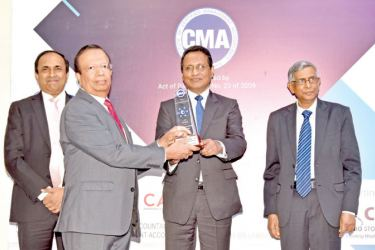 Ceylinco Life Director Palitha Jayawardena accepts the CMA Integrated Reporting award on behalf of the Company