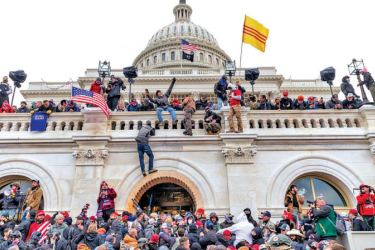 Pro-Trump supporters storming the US Capitol building in an attempt to overturn the results of the 2020 Presidential election.