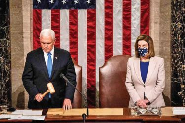 U.S. Vice President Mike Pence and U.S. House Speaker Nancy Pelosi preside over a joint session of Congress to count the Electoral College votes of the 2020 Presidential election in the House Chamber in Washington, D.C., U.S., on January 6, 2021