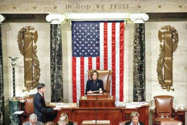 US House Speaker Nancy Pelosi holds the gavel as House lawmakers vote on whether to impeach US President Donald Trump for a second time.
