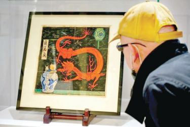 """Painting for the original cover of """"The Blue Lotus"""" Tintin comic book auctioned by Artcurial in Paris."""