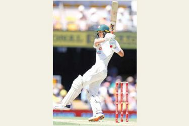 Australia's Marnus Labuschagne hits the ball for a boundary on day one of the final Test match against India at the Gabba in Brisbane. - AFP