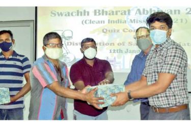 A recipient being given a package of sanitary items.