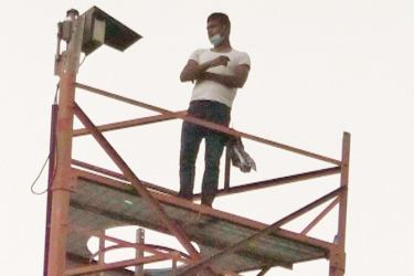 The man protesting on the tower.
