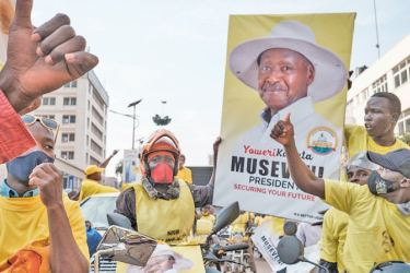 Supporters of the National Resistance Movement (NRM) celebrate the victory of President Yoweri Museveni after the results of the presidential election in Kampala, Uganda on Saturday. -AFP