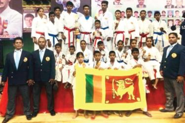The Karate contingent from Sri Lanka for the International Shimogo Open Championship held in Bangalore, India posed for a photograph with the officials after the tournament in 2018. Dasun Sathsara is standing sixth from left in the back row. (Picture by Dilwin Mendis – Moratuwa Sports Special Correspondent)