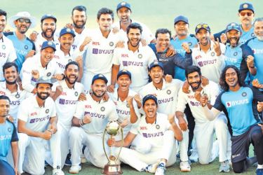 Indian players and officials celebrate with the winning trophy at the end of the fourth cricket Test match between on Tuesday. AFP