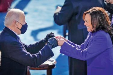 U.S. President Joe Biden fist bumps Vice President Kamala Harris after she took the oath of office on the West Front of the U.S. Capitol on Wednesday  in Washington, DC.