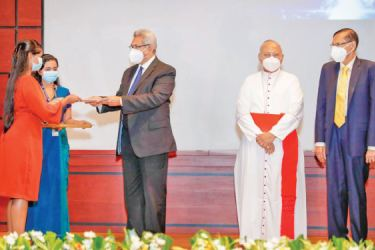 President Gotabaya Rajapaksa officially presents the letter of enrollment to the first undergraduate students of BCI Campus.  His Eminence Malcolm Cardinal Ranjith, the Archbishop of Colombo and Prof. G.L Peiris, Minister of Education awas also present in the picture