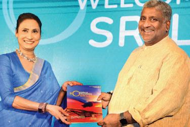 Chairperson Sri Lanka Tourism Kimarli Fernando presents the 'safety' tourism booklet to Minister Ranatunge. Picture by Wimal Karunathillake