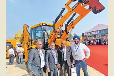 Assistant General Manager Marketing, Walkers Equipment Prasanna Katuwandeniya, CEO Rozan Jameel, Assistant General Manager After Sales Chinthaka Perera and International Business and Strategy Gurminder Singh Malik, after confirming the BULL dealership to Walkers Equipment in Bangalore EX-con Exhibition premises