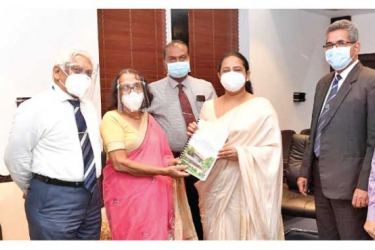 Health Minister Pavithra Wanniarachchi receiving the report.