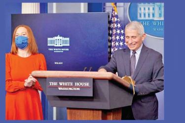 Dr. Anthony Fauci and White House Press Secretary Jen Psaki speaking to reporters during the daily White House briefing on Thursday.