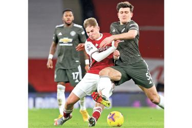 Action from the match between Manchester United and Arsenal