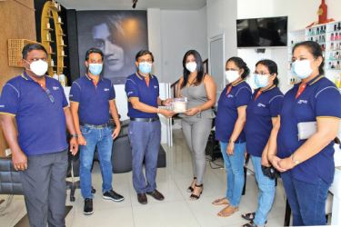 Senior Deputy General Manager K.B. Rajapaksa Payment and Digital presents the LankaQR facility to a customer