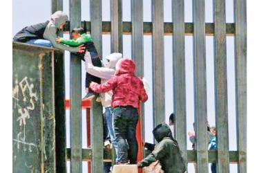 """President Joe Biden signed orders to end a 2018 """"zero tolerance"""" policy on prosecuting illegal border crossings and to seek unification of parents with children detained at the border. Only unaccompanied minors are covered by the ruling."""