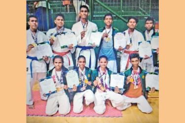 The karate contingent of UKF Karate Academy which participated at the Shimoga Open International Karate Championship in Bangalore, India in 2018. Hiruni Navodya Herath squatting in the front row second from left. (Picture by Dilwin Mendis Moratuwa Sports Special Correspondent)