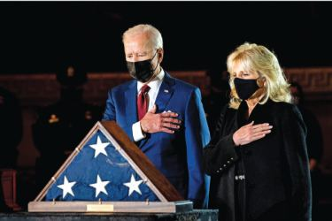 President Joe Biden and First Lady Jill Biden pay their respects to the late Capitol Police Officer Brian Sicknick who lies in honour in the Rotunda of the Capitol in Washington, DC on Tuesday. - AFP