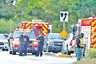 Law enforcement officers block an area where a shooting killed two FBI agents while serving an arrest warrant in Sunrise, Florida on Tuesday.