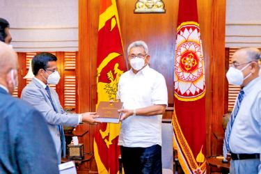 The Final report of the Presidential Commission of Inquiry (PCoI) probing the Easter Sunday terror attacks was handed over to President Gotabaya Rajapaksa by its Chairman Supreme Court Justice Janak de Silva at the Presidential Secretariat recently. Picture courtesy President's Media Division