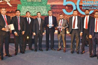 The winning team of CBL Samaposha accepting the awards.