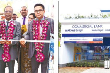 Commercial Bank Chairman Justice K. Sripavan flanked by the Bank's Managing Director S. Renganathan and Chief Operating Officer S. Manatunge and accompanied by members of the corporate and senior management formally declares open the new Trincomalee branch building