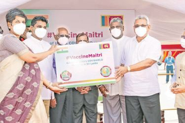President Gotabaya Rajapaksa hands over a consignment of the Covishield vaccine gifted by India to State Minister Dr. Sudarshani Fernandopulle.