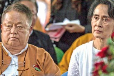 Win Htein, Chief Executive Committee member of the National League for Democracy (NLD) with Myanmar's State Counselor Aung San Suu Kyi (R) in this file photo taken on August 17, 2017. - AFP