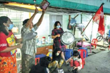 Residents of Yangon bang pots and pans in protest of the recent Myanmar military coup.