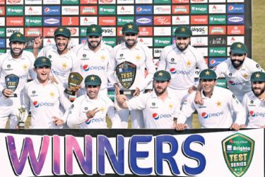 Pakistan's players pose for photographs with trophies after winning the Test series against South Africa during the fifth and final day of the second Test cricket match between Pakistan and South Africa at the Rawalpindi Cricket Stadium in Rawalpindi on February 8. AFP