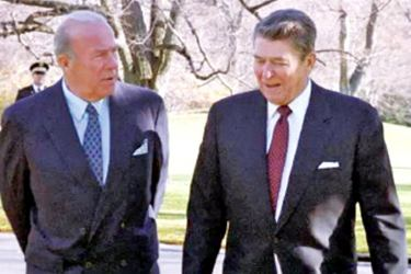 Former US Secretary of State George Shultz with former US President Ronald Reagan