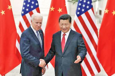 Chinese President Xi Jinping with then U.S. Vice President Joe Biden in this 2013 photo.