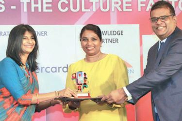 99x COO Shehani Seneviratne (centre) and 99x Chief People Officer Damitha Jayasinghe (right) receiving the Best Workplace for Women award from The Great Place to Work Institute Sri Lanka CEO Kshanika Ratnayaka