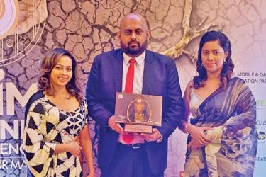 Tharindu Lorenso Hewage, the Company's Assistant Manager Tea flanked by Goonawardena and Thiska Goonatilleka, Manager Business Development at the awards ceremony