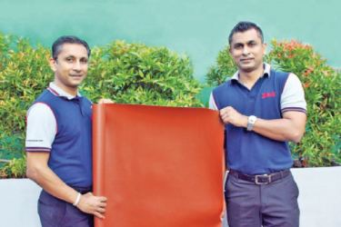 Managing Director of DSI, Kasun Rajapaksa and Executive Director of DSI, Dilshan Rajapaksa displays the synthetic leather sheet