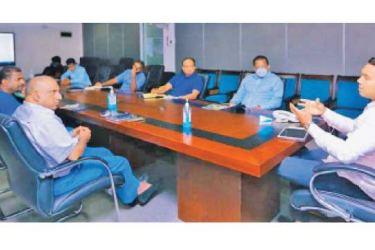 Sports Minister Namal Rajapaksa (right) in conversation with Cricket Committee members