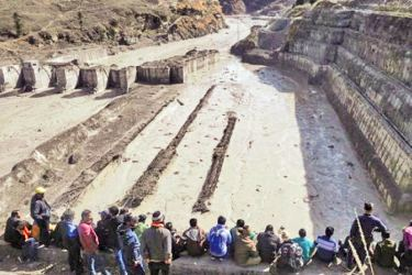 A dam along a river in Tapovan was severely damaged in the flash flood.